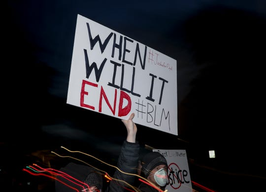 A supporter holds up a sign during a peaceful rally, celebrating black culture and remembering George Floyd and other victims of police violence, in Salem, Oregon on Tuesday, June 2, 2020.