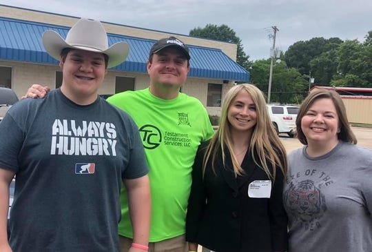 Calvary's Kailey Brookshire (third from left) with some of her supporters after enlisting in the Marine Corps.