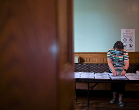 Connie Ideker sorts ballots on Wednesday, June 3, 2020 at the Old Courthouse Museum in Sioux Falls.
