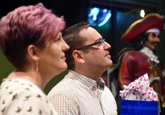 Greg Neitzert watches an update on election results with his wife, Jennifer, on Tuesday, June 1, at Shenanigan's in Sioux Falls.