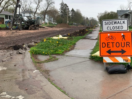 A pedestrian detour sign on 7th Street is part of the Southeast infrastructure improvement project this summer in Dell Rapids.