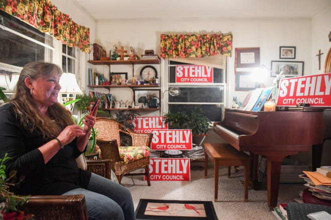 Theresa Stehly speaks to fellow city councillor Pat Starr on the phone while waiting for election results on Tuesday, June 1, at her home in Sioux Falls.