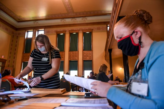 Sydney Tuttle and Melissa Beek sort through ballots on Wednesday, June 3, 2020 at the Old Courthouse Museum in Sioux Falls.