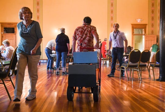Ken Allender wheels ballot boxes into the room on Tuesday, June 1, at the Old Courthouse Museum in Sioux Falls.