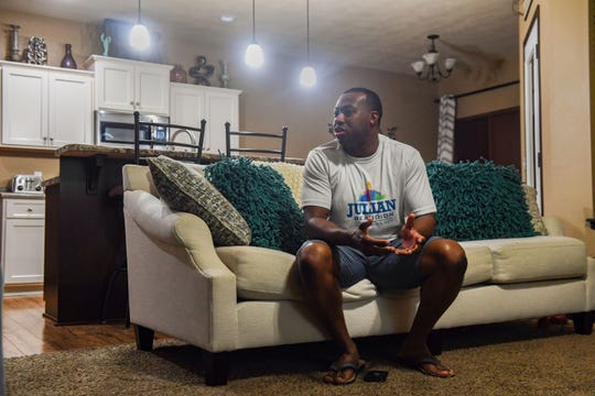 Julian Beaudion stays awake while waiting for election results on Tuesday, June 1, at his home in Sioux Falls.