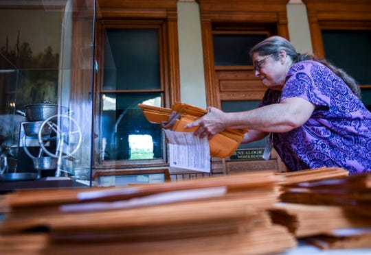 Dawn Hartigan sorts ballots on Wednesday, June 3, 2020 at the Old Courthouse Museum in Sioux Falls.