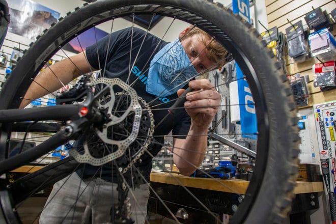 Marcus Betts, a bike technician at Higher Ground Bicycle Co., works on a bicycle Tuesday, June 2, 2020.