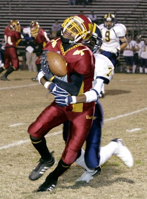 Tulare Union's Barry Wilson is caught by Sunnyside's Brian Duckworth in their Division 2 playoff game at Bob Mathias Stadium in Tulare November 19, 2004.