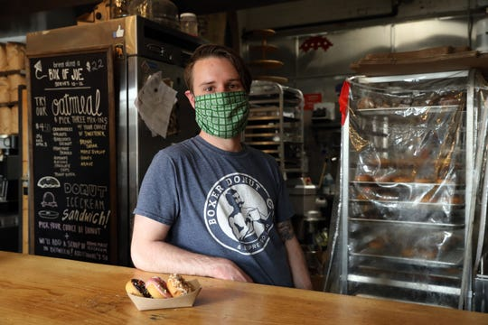 Owner Eric Brown at Boxer Donut and Espresso Bar in Nyack June 2, 2020. After a short break during the pandemic, Brown reopened for curbside pickup with limited menu and limited hours.