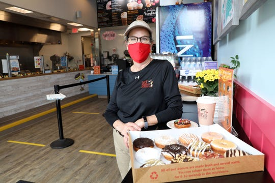 Owner Bonnie Foncello with a selection of doughnuts at Duck Donuts in Mamaroneck June 2, 2020. The shop has stayed open during the pandemic with social distancing guidelines in place.