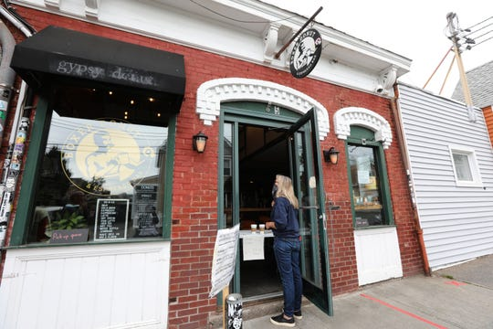 A customer orders at the door of Boxer Donut and Espresso Bar in Nyack June 2, 2020. After a short break during the pandemic, the shop reopened for curbside pickup with limited menu and limited hours.