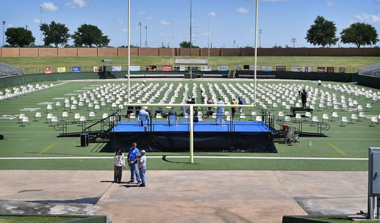 Wichita Falls ISD staff set up equipment in preparation for graduation ceremonies at Memorial Stadium Wednesday.