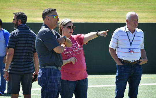 Wichita Falls ISD superintendent Michael Kuhrt, Ashley Thomas and Brady Woolsey talk over details as they prepare for graduation ceremonies to be held at Memorial Stadium Thursday, Friday and Saturday morning.