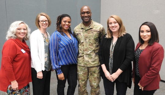 Military spouses are seen with SAFB Commander Col. Kenyon Bell at a Chamber BOSS panel discussion.
