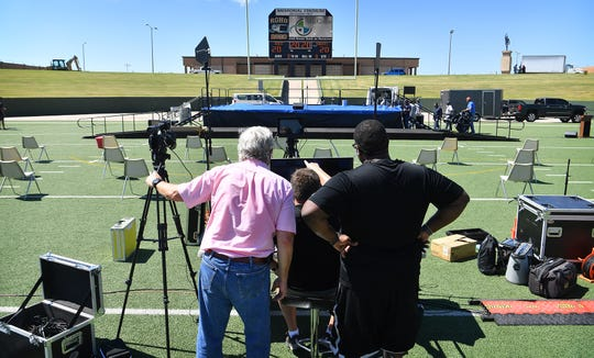 Mayfield Events personnel set up for the video production portion of the three WFISD graduation ceremonies Wednesday morning.