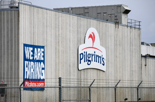 This April 28, 2020 file photo shows the Pilgrim's Pride plant in Cold Spring. Minn. A federal grand jury has charged four current and former chicken company executives with price-fixing. The U.S. Department of Justice says the executives from Colorado-based Pilgrim' Pride and Georgia-based Claxton Poulrty conspired to fix prices and rig bids for broiler chickens from at least 2012 to 2017.(Dave Schwarz/St. Cloud Times via AP)