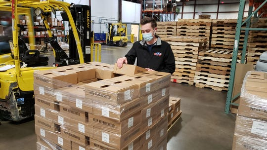 A delivery of cheese products from Emmi Roth arrives at the Second Harvest Food Bank in Madison. An information platform is helping to make the process of connecting food banks with food suppliers transparent.