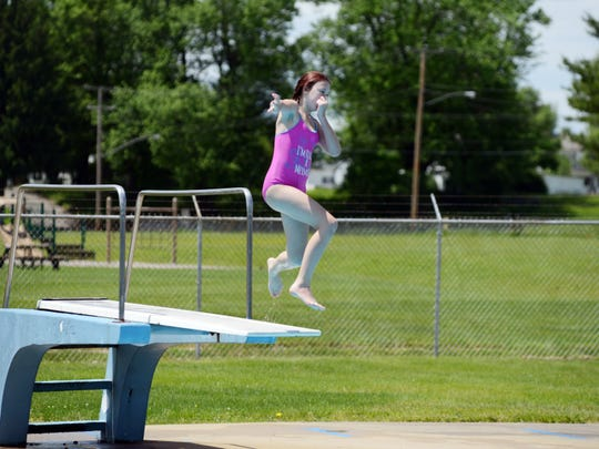 A swimmer uses the diving board on Saturday at the Frazeysburg Pool.