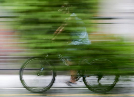 A cyclist wearing a protective mask passes by a newly opened bicycle lane in San Juan city, Metro Manila, Philippines in observance of World Bicycle Day on June 3, 2020. Several cities opened bicycle lanes as people use different ways of commuting while public transport remains limited during a more relaxed lockdown to prevent the spread of the new coronavirus.