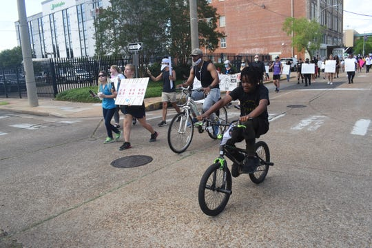 Several hundred people bicycled and walked through downtown Alexandria on Wednesday afternoon to protest police brutality and the deaths of African-Americans by police.
