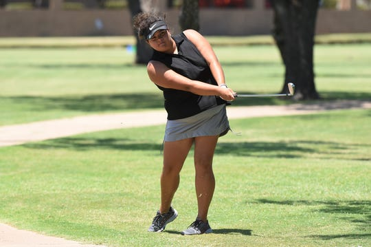 Abilene's Sarah Aitchison follows through on a shot during the second round of the WTJCT West Texas Junior Open at the Abilene Country Club North Course on Thursday. Aitchison shot a 75 in each round to finish as the Girls 15-18 runner-up.