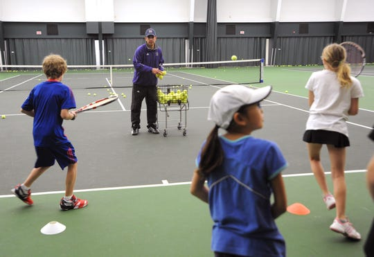 Juan Nunez teaches a winter tennis camp at ACU while serving as a graduate assistant for the Wildcats in 2009. Nunez was named head coach for both the men's and women's tennis  program at ACU on Wednesday.