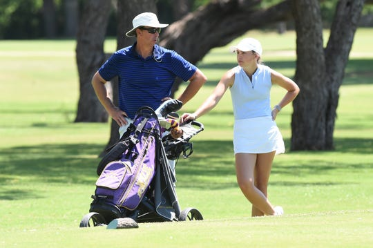 Tatum and Mark McClellan talk at the No. 14 tee box during the second round of the WTJCT West Texas Junior Open at the Abilene Country Club North Course on Thursday, June 4, 2020.