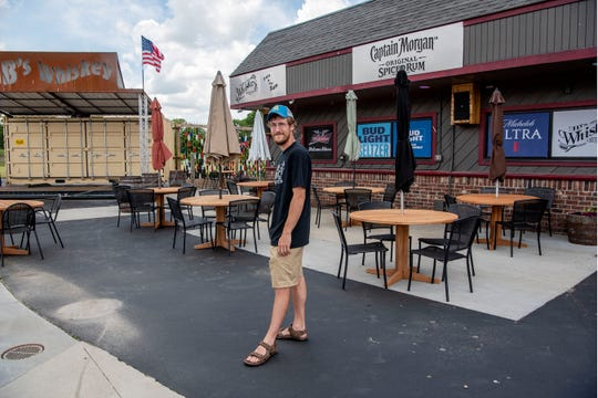 Restaurant owner Devin Bloomfield stands for a portrait on Thursday, June 4, 2020 at JB's Whiskey in Springfield, Mich. JB's Whiskey will reopen on Monday at 50% capacity with patio seating available.