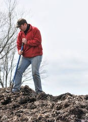 Matt White stands on top of a pile of mulch while volunteering for VINES (Volunteers Improving Neighborhood Environments). White was recently awarded the Golden Pepper Award from VINES for his volunteer work.