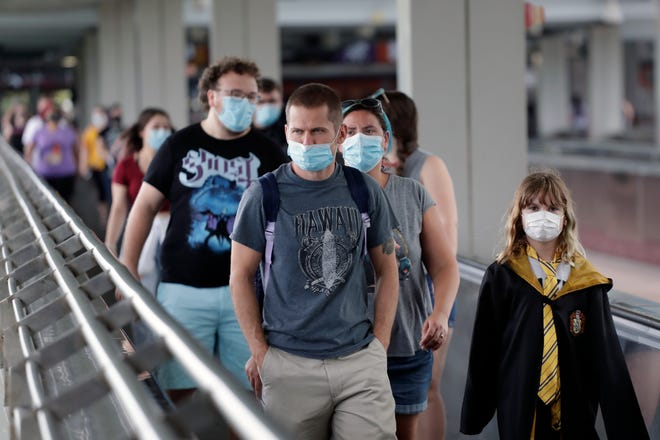 Park visitors wear masks and had their temperature checked before entering Universal Orlando Resort. The park reopened to the general public on June 5.