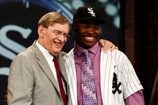 Chicago White Sox draft pick Courtney Hawkins is greeted by MLB Commissioner Bud Selig  at the 2012 MLB Draft  June 4, 2012 at  MLB Networks in Secaucus, NJ.