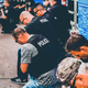 Canton police officers kneel in prayer with protesters in downtown Canton on Wednesday, the same day a Canton police officer resigned after writing a racially threatening social media post.