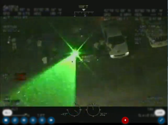A U.S. Customs and Border Protection helicopter was hit with a laser beam during a flyover the protests in downtown Detroit Wednesday.
