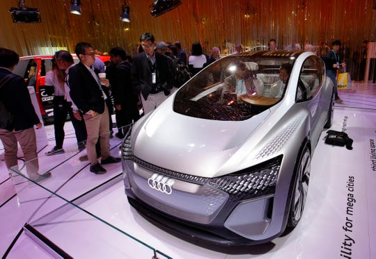In this Jan. 8, 2020, file photo, the Audi AI:ME self-driving concept vehicle is on display in the Audi booth at the CES tech show in Las Vegas.