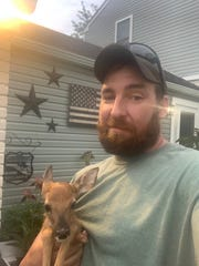 Ryan Boik with Little Ryan, the fawn he saved from I-75. (Ryan Boik, special to the Free Press)