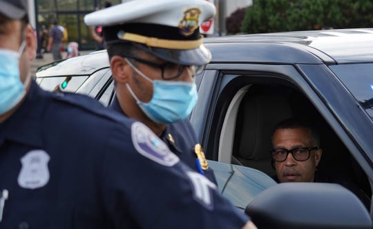 Detroit Police Chief James Craig arrive as protesters march through Detroit on the sixth day of protests against police brutality on Wednesday, June 3, 2020.