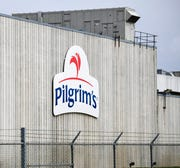 This April 28, 2020 file photo shows the Pilgrim's Pride plant in Cold Spring. Minn. A federal grand jury has charged four current and former chicken company executives with price-fixing.