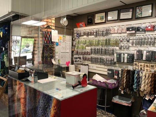 A sneeze guard has been installed at the checkout counter inside Heritage Spinning & Weaving, which is scheduled to reopen in July.