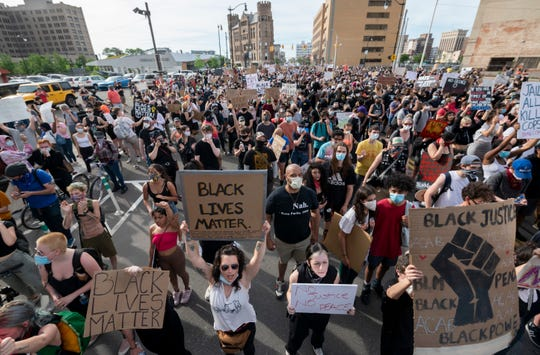 Demonstrators march along Cass Ave. in Detroit to protest the death of George Floyd, June 3, 2020.