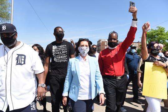 Lt. Gov. Garlin Gilchrist II, middle left, and Gov. Gretchen Whitmer attend a march against police brutality in Highland Park on June 4.