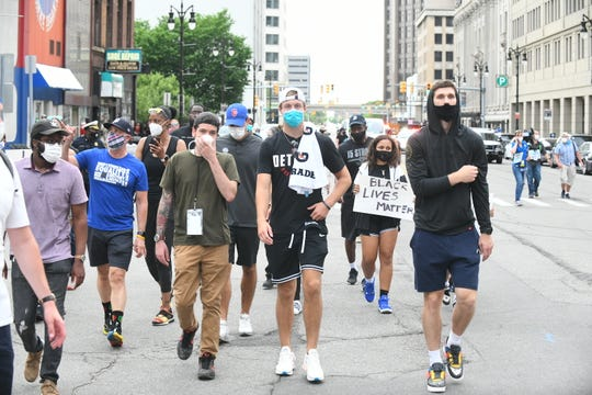 Detroit Pistons Luke Kennard, left, and Sviatoslav Mykhailiuk march on Michigan Avenue in Detroit with demonstrators to protest the death of George Floyd June 4, 2020.