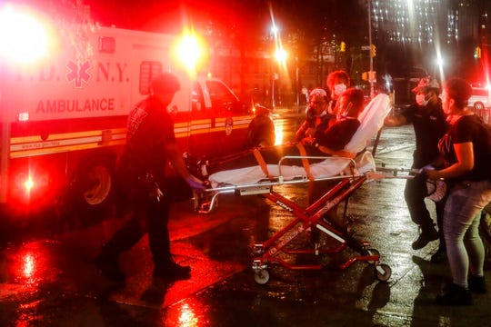 A protester is loaded into an ambulance after a rally calling for justice over the death of George Floyd, Wednesday, June 3, 2020, in the Brooklyn borough of New York.