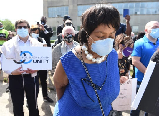 Detroit City Council President Brenda Jones prays before the start of the rally in Highland Park in honor of George Floyd, a man who died last week while being arrested by Minneapolis police, Thursday, June 4, 2020.