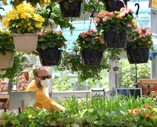 Rob Lee, of Oak Park, does his garden shopping at English Gardens Thursday. Demand is up at nurseries ever since the governor let them reopen April 24, with many reporting blockbuster sales in May.