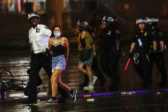 New York City police officers arrest protesters following a rally calling for justice over the death of George Floyd, Wednesday, June 3, 2020, in the Brooklyn borough of New York.