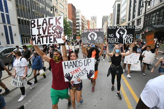 Demonstrators walk down Woodward Ave. in Detroit, June 4, 2020, to protest the death of George Floyd.