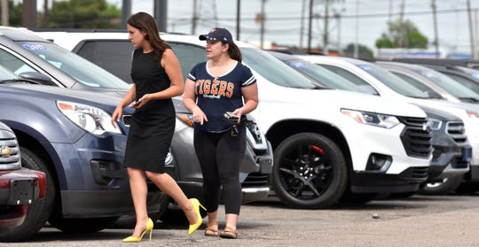 Sales consultant Jenna Mosser, left, of Brighton, shows used cars to customer Amber Cicalo, of Madison Heights.  People shop for cars at Matthews-Hargreaves Chevrolet in Royal Oak, Thursday afternoon, June 4, 2020,
