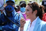 Gov. Gretchen Whitmer speaks during a unity march in Highland Park and Detroit on Thursday, June 4, 2020.