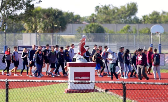 In this March 14, 2018 file photo, Students from Marjory Stoneman Douglas High School walkout to the football field for 17 minutes of silence in honor of the 17 victims killed at the school.