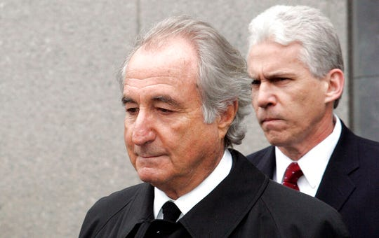 In this March 10, 2009, file photo, former financier Bernie Madoff exits federal court in Manhattan, in New York.